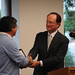 President Rush presents Dr. Muraoka with award at the Awards Dinner, April 2009.