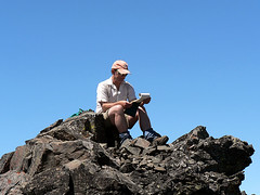 Mike reads the summit register on the summit Volcanic Neck, 7.29.07.