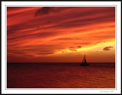 Aruba Fire in the Sky (Paul_Wheeler) Tags: sunset red sea vacation sky orange sun holiday seascape hot nature water clouds landscape happy fire coast boat nikon bravo waves sailing framed relaxing scenic aruba exotic sail romantic caribbean waterscape 3100 e3100 tamarijn flickrsbest superaplus aplusphoto ultimateshot superbmasterpiece diamondclassphotographer flickrdiamond 15challengeswinner excellentphotographerawards flickrphotoaward excapture flickrslegend diamondexcapture