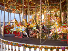Wild ornate Merry-Go-Round (carousel) with Horses named Sara, Sammy, Nick, and Phillip, Palace Pier, Brighton, England, UK