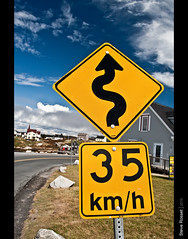 Curves Ahead (Steve Rosset) Tags: road travel blue vacation sky white canada abstract tourism nova sign yellow clouds rural landscape geotagged fishing highway novascotia village slow bright path cove vibrant small scenic canadian atlantic september trail coastal signage roadside scotia peggy peggys peggyscove turns twisty maritimes 2010 steverosset