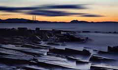 Longniddry Sunset (ajnabeee) Tags: longexposure blue sunset blur water misty clouds scotland movement rocks edinburgh dusk scottish forth
