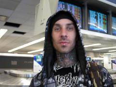 celebrity sighting (joujoubee) Tags: triptomaine celebrity lga laguardiaairport airport blink182 tatoos blurry