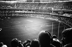 captain snooze at the footy (mugley) Tags: people blackandwhite sport football stadium crowd australia melbourne victoria olympusxa2 funnyhat mcg afl australianrules ilfordxp2super400 14july2007 collingwoodvsgeelong