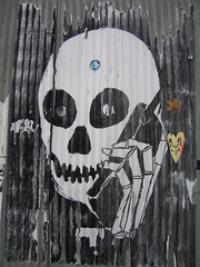 NYC 303 Skeleton on cell phone - pasteup photo by watz