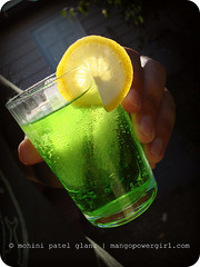 green apple soda with a slice of ... (mohini :: mangopowergirl.com) Tags: sunlight green apple yellow jones lemon flickr hand drink sunny bubbles august explore slice soda sunlit fizzy 2007 320 22nd brianglanz