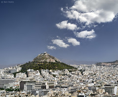 Athens from the Acropolis (Ben Heine) Tags: city summer wallpaper panorama mountain art history tourism clouds buildings landscape photography volcano high scenery holidays view lego cloudy top altitude smoke horizon atmosphere bluesky athens smoking pointofview pollution destination unusual nuages paysage acropolis athena legend mythology grce ville colline touristic volcan kolonaki whitehouses funicularrailway theartistery justclouds benheine mountlycabettus vertorama samsungimaging samsungnx10 cretaceouslimestonehill aristippoustreet