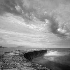 The Cobb II (Adam Clutterbuck) Tags: ocean uk longexposure greatbritain sea england blackandwhite bw cloud seascape monochrome square landscape mono coast pier blackwhite bn coastal shore elements dorset gb cobb bandw sq oe lymeregis lyme regis breakwater thecobb greengage adamclutterbuck sqbw bwsq showinrecentset openedition