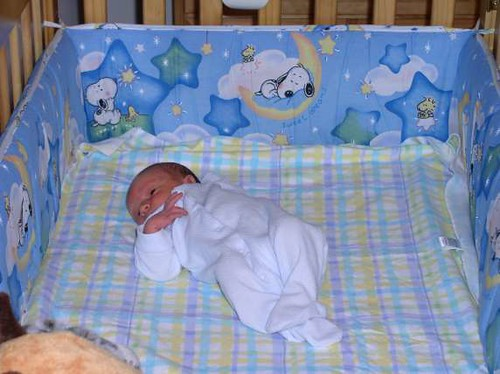 So tiny in his BIG crib
