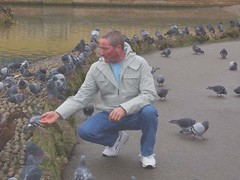 Feeding the birds (annteebee) Tags: park lake man birds duck feeding pigeons
