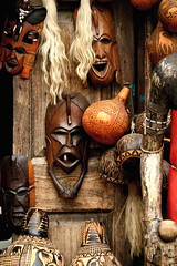 Masks (The Wandering Angel) Tags: africa travel reflections souvenirs wooden forsale faces kenya exotic masks items cultures sights mombasa theperfectphotographer