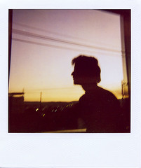 cristovo (Fbio Lamounier) Tags: sunset portrait sunlight male film up vintage polaroid one afternoon close step 600 expired cristovao gois