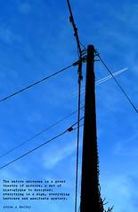 utility pole (HUNGRYGH0ST) Tags: blue sky plane power aircraft telephone text utility cable minimal pole pylon diagonal trail parallel telegraph vapour vapor synchronicity insulator