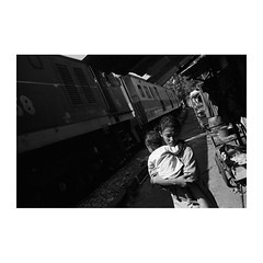 . (Emmanuel Smague) Tags: poverty leica travel family people blackandwhite bw woman baby film train 35mm thailand photography asia report transport mother documentary railway transportation mp misery precariousness emmanuelsmague alongtherailway
