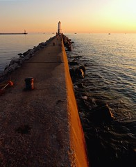 North Pier path to the Lighthouse (jimflix!) Tags: county sunset lighthouse water bay harbor pier rocks outdoor michigan scenic lakemichigan panasonic boulders betsie breakwater frankfort elberta benzie m22 m115 outdoorbeauty scenicmichigan fz18 scenicsnotjustlandscapes frankfortharbor jimflix llmsmifrankfort
