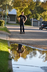 Reflect (kylehagen37) Tags: road street autumn man reflection fall water fun stand pond pavement driveway longboard reflective longboarding lrg