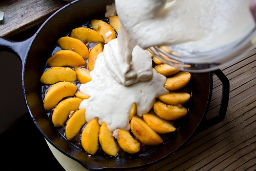 Pouring batter over peaches