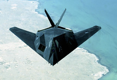 Public Domain: F-117 Flying Over Persian Gulf by Derrick C. Goode USN, 2003 (DOD 030414-F-0365G-002) - by pingnews.com