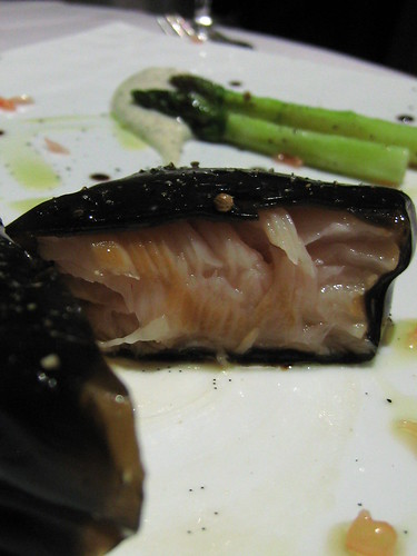 Opening up the salmon poached in asparagus