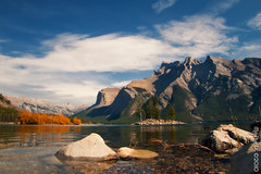 One green, one orange - islands in the sun (JoLoLog) Tags: lake canada mountains fallcolors canoneos20d alberta rockymountains banffnationalpark moshe lakeminnewanka thecanadianrockies mygearandmepremium mygearandmebronze mygearandmesilver mygearandmegold