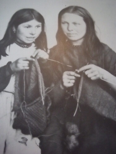 Final stages of construction in these knit-frocks, show the skills of two young Polperro girls