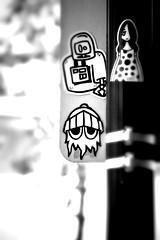 the cool out (damonabnormal) Tags: street city urban blackandwhite bw streetart philadelphia june canon graffiti sticker stickerart dof bokeh 33 label stickers streetphotography urbanart pa labels philly slap phl 2010 215 celsius slaps tiltshift blip radius uwp citystickers streetstickers underwaterpirates philadelphiastreetart 40d philadelphiagraffiti philadelphiaartist