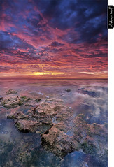 Exogenesis (juandiegojr) Tags: longexposure blue red sea sky espaa orange costa seascape verde green beach azul clouds sunrise reflections landscape coast mar spain rojo sand rocks offshore playa muse arena am