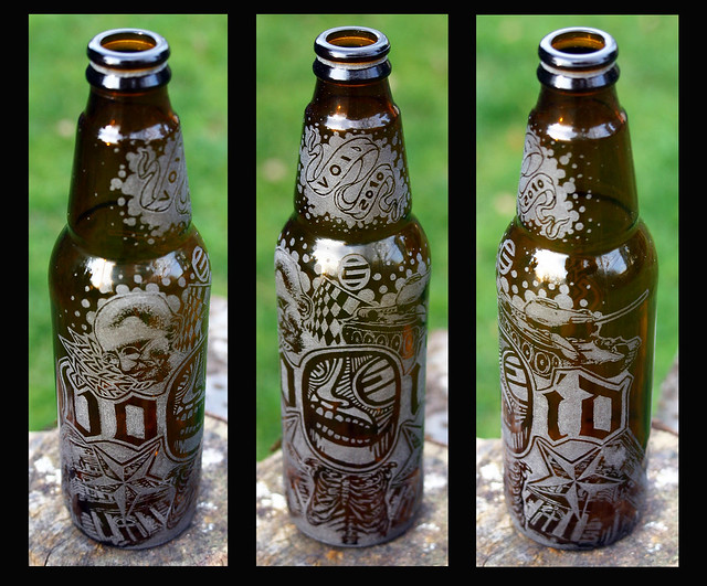 beer bottle tattoo. engraving on beer bottle. gravírozott üveg