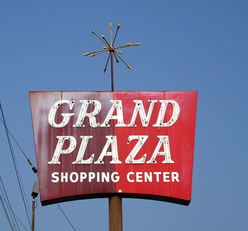 grand plaza shopping center neon sign