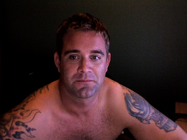 computer and decided to take pictures of himself and his ugly tattoos,