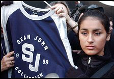 Sean John Clothing Line For Women A worker making Sean John