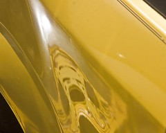 The Scream in Yellow.12 (mcreedonmcvean) Tags: reflection wichitafalls damaged oldcars yellowpaint miserjunkyard