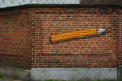 An orange pencil on a wall, Brussels (Lola Casamitjana) Tags: street brussels orange wall pencil bricks bruxelles crayon rue mur briques