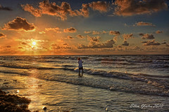 Gone Fishing (Ellen Yeates) Tags: ocean travel summer vacation sky orange cloud sun seaweed bird beach water lady sunrise canon austin ellen fishing texas cloudy wave gone freeport dri hdri surfside yeates gavleston