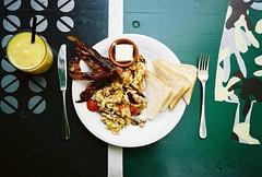 full english? (lomokev) Tags: food berlin bacon nikon fuji superia egg butter orangejuice fryup 35ti fujisuperia fujisuperia400 nikon35ti file:name=070730nikon35ti15