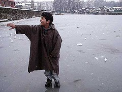 Kashmiri boy on  Frozen Dal Lake (kamrazi) Tags: boy lake frozen dal kashmiri