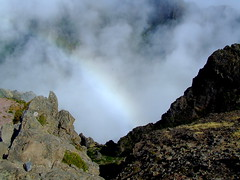 rainbow chaser (oewimmie) Tags: mist mountains portugal rock stone clouds walking high rainbow wind valley pico madeira damp s5600 fujifilmfinepixs5600 picodoarieiro ilustrarportugal parquenaturaldamadeira