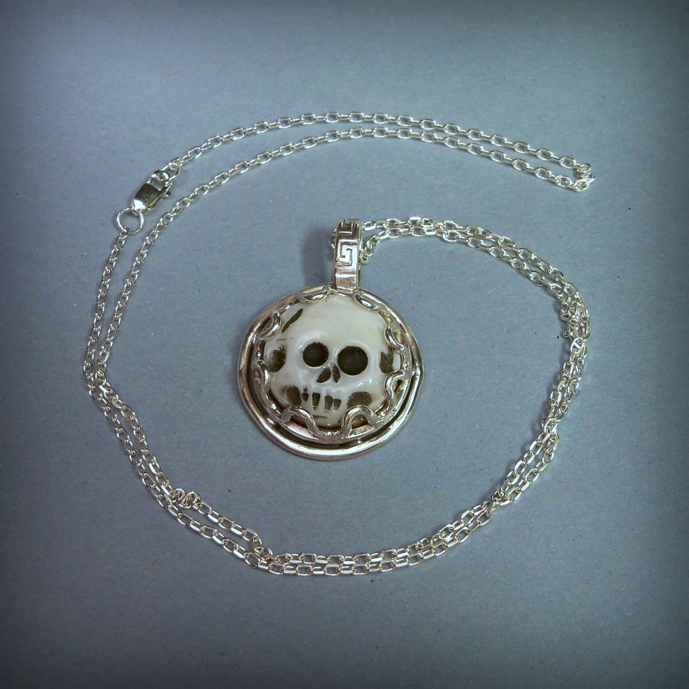 Morrigan's Favor Harvest moon Pendant with mother of pearl Skull moon cameo  copper and Brass moon set in sterling silveron 20 inch sterling silver chain.