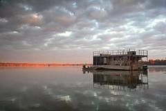 The Lake Martin Houseboat (Ben Pierce Photography) Tags: morning sunlight lake reflection water clouds sunrise la boat louisiana kayak south paddle houseboat swamp acadiana lakemartin benpierce
