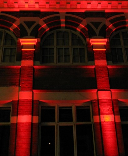 Red lit building in Belfast