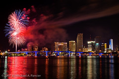 A Miami Fourth Celebration (Michael Pancier Photography) Tags: usa skyline florida fireworks miami fourthofjuly july4 independenceday 2007 fineartphotography naturephotography seor lrps watsonisland naturephotographer floridaphotographer michaelpancierphotography colorphotoaward superbmasterpiece onlythebestare wwwmichaelpancierphotographycom seorcohiba