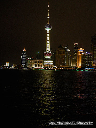 Oriental Pearl Tower with water reflection at night