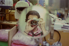 city self 1 (scott w. h. young) Tags: street nyc newyorkcity portrait sun film self 35mm mirror manhattan midtown vendor