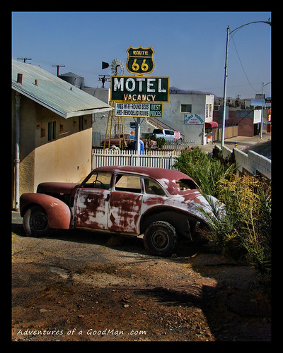 An old car lays rusting by a Route 66 motel in Barstow, California