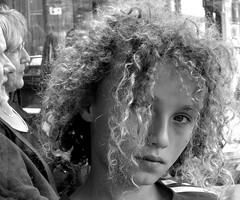 don't fool me (Amsterdamned!) Tags: lighting family light boy portrait blackandwhite bw blancoynegro topf25 face amsterdam hair book eyes nikon natural emotion terrace expression retrato candid strangers streetphotography streetportrait curls son bn cinematography gaze spui themoulinrouge barrestaurant 25faves aplusphoto visiongroup excapture streetportraitclassics