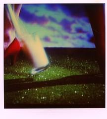 MTV: Red Heel, Green Grass + Milk (danagraves) Tags: polaroid mtv musicvideo 1990s darksky greengrass tvshot glassofmilk redhighheel spillingmilk