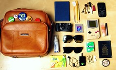 what's in my bag? june 2010 edition. (Lillybet Magdalena) Tags: sunglasses pencils gum keys book phone wallet buttons eraser disposablecamera mp3player badges passport gameboy lipgloss tetris bobbypins handsanitizer elastics samsonitebag withphotoofjamesandi tattoomajik