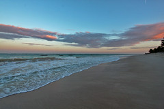 Evening Glow over Diani Beach (lens buddy) Tags: africa sea sky holiday beach clouds hotel coast sand kenya indianocean restaurants palmtrees pools mombasa beautifulplaces dianibeach southernpalms