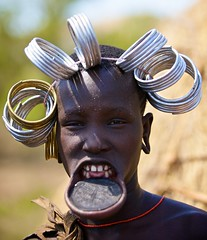 Mursi tribe Ethiopia 24 (ingetje tadros) Tags: africa travel portrait people art faces unique culture tribal clay tribes omovalley tradition mursi adornment omo mursitribe lipplate tribaljewelry ingetjetadros
