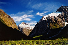 Summer in Fiordland (Daniel Murray (southnz)) Tags: morning blue shadow newzealand summer sky mountain snow creek landscape monkey nationalpark scenery peak mount valley nz southisland talbot fiordland hollyford southnz eos50escanfromprint